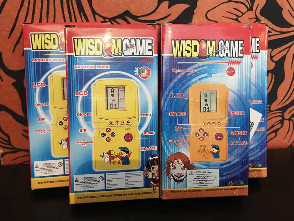 Wisdom Game boxes back