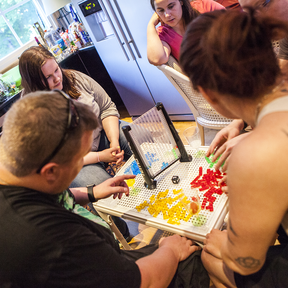 People playing Tetris Link board game